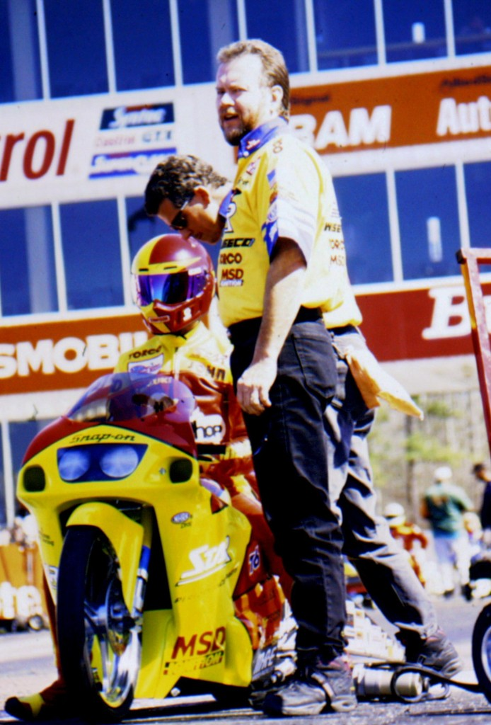 George Bryce, Ken Johnson and the late John Myers prepare to do battle as George gives the race track one final look before unleashing John Myers. From 1989 to 1998 Myers amassed 33 national event wins and qualified number one 38 times during his career. Photo © Tom McCarthy