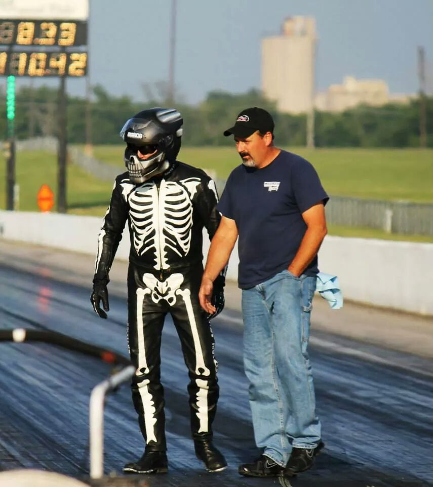 Mark Rendeluk and his crewman Chris walk the dragstrip.
