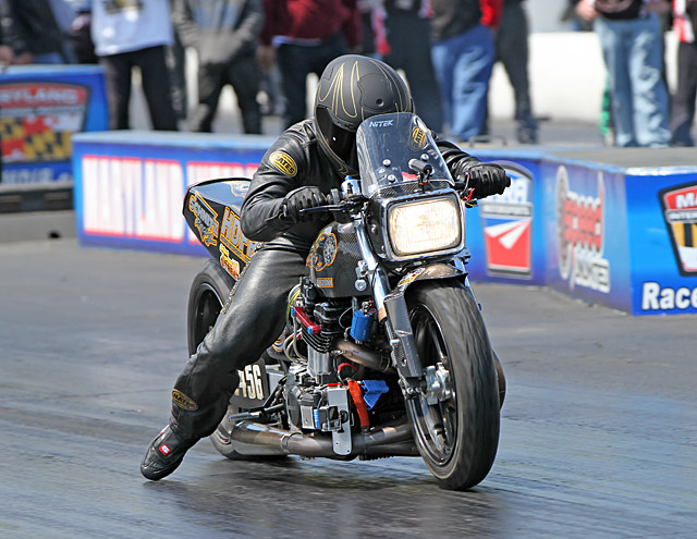 Richard Gadson on Brad Mummert's old school, air-cooled Suzuki GS