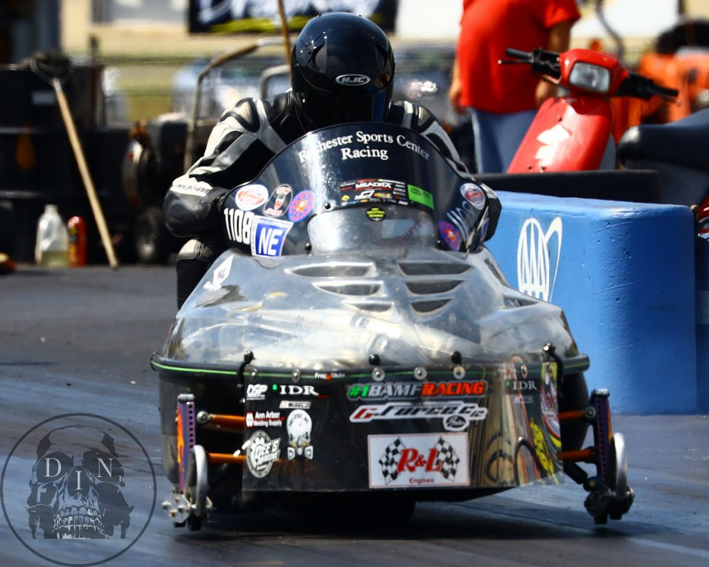 Carl Cicchetto – Hard Launch by Carl Cicchetto on his drag sled at New England Dragway during the annual New England Dragway Motorcycle Masters competition. Tom McCarthy photo.