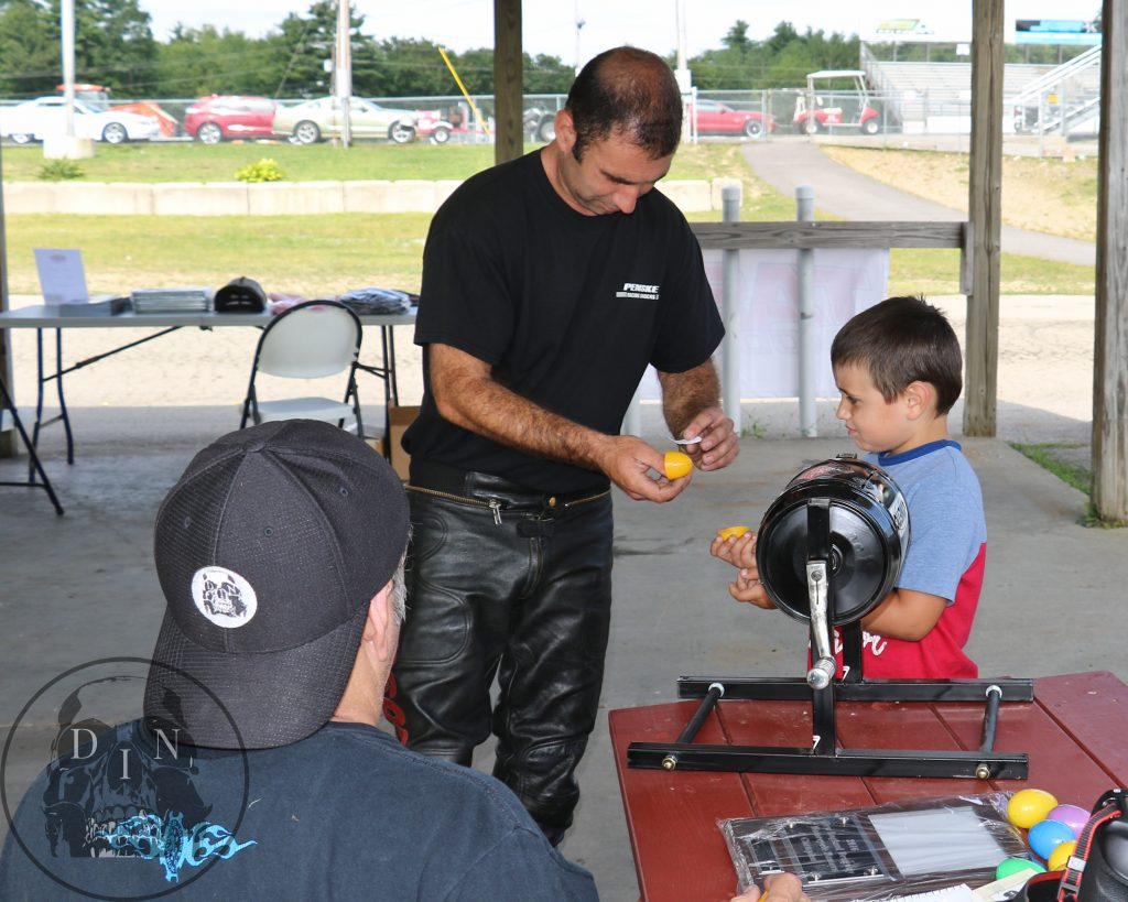 Tony Ficher gets a little help from his son is choosing a name during the Masters selection process. Tony was runner-up in year one of the Master race and he made it to the Semi-Finals this year. Pat Sullivan photo.